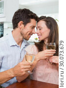 Купить «Loving couple with wine glasses at home», фото № 30073679, снято 12 декабря 2013 г. (c) Wavebreak Media / Фотобанк Лори