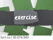 Купить «Exercise against green paper strewn over notepad», фото № 30074943, снято 22 марта 2014 г. (c) Wavebreak Media / Фотобанк Лори