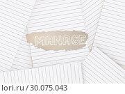 Купить «Manage against lined paper strewn over surface», фото № 30075043, снято 22 марта 2014 г. (c) Wavebreak Media / Фотобанк Лори