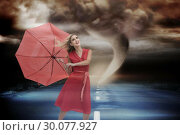 Купить «Composite image of elegant blonde holding umbrella», фото № 30077927, снято 25 марта 2014 г. (c) Wavebreak Media / Фотобанк Лори