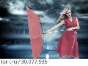 Купить «Composite image of elegant blonde holding umbrella», фото № 30077935, снято 25 марта 2014 г. (c) Wavebreak Media / Фотобанк Лори
