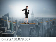 Купить «Composite image of businesswoman performing a balancing act», фото № 30078507, снято 28 марта 2014 г. (c) Wavebreak Media / Фотобанк Лори