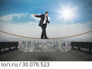 Купить «Composite image of mature businessman doing a balancing act», фото № 30078523, снято 28 марта 2014 г. (c) Wavebreak Media / Фотобанк Лори