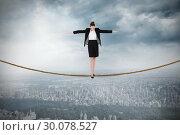 Купить «Composite image of businesswoman performing a balancing act», фото № 30078527, снято 28 марта 2014 г. (c) Wavebreak Media / Фотобанк Лори