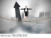 Купить «Composite image of businesswoman performing a balancing act», фото № 30078531, снято 28 марта 2014 г. (c) Wavebreak Media / Фотобанк Лори