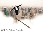 Купить «Composite image of businesswoman performing a balancing act», фото № 30078539, снято 28 марта 2014 г. (c) Wavebreak Media / Фотобанк Лори