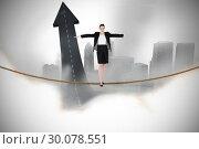 Купить «Composite image of businesswoman performing a balancing act», фото № 30078551, снято 28 марта 2014 г. (c) Wavebreak Media / Фотобанк Лори
