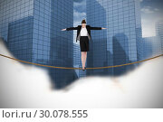 Купить «Composite image of businesswoman performing a balancing act», фото № 30078555, снято 28 марта 2014 г. (c) Wavebreak Media / Фотобанк Лори