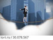 Купить «Composite image of businesswoman performing a balancing act», фото № 30078567, снято 28 марта 2014 г. (c) Wavebreak Media / Фотобанк Лори