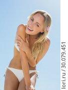 Купить «Beautiful blonde in white bikini smiling at camera on the beach », фото № 30079451, снято 14 февраля 2014 г. (c) Wavebreak Media / Фотобанк Лори