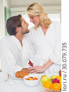 Купить «Cute couple in bathrobes having breakfast together», фото № 30079735, снято 24 января 2014 г. (c) Wavebreak Media / Фотобанк Лори