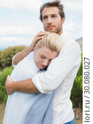 Купить «Protective man hugging his girlfriend in blue blanket outside», фото № 30080027, снято 24 января 2014 г. (c) Wavebreak Media / Фотобанк Лори