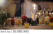 Colored cocktail ingridients in glasses and a candle stand on a bar counter. Стоковое видео, видеограф Константин Шишкин / Фотобанк Лори