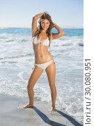 Купить «Beautiful smiling woman in white bikini standing on the beach», фото № 30080951, снято 12 февраля 2014 г. (c) Wavebreak Media / Фотобанк Лори
