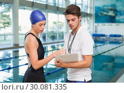 Купить «Swimmer discussing times with her coach by the pool», фото № 30081335, снято 26 февраля 2014 г. (c) Wavebreak Media / Фотобанк Лори