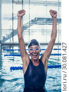 Купить «Excited swimmer jumping up the swimming pool», фото № 30081427, снято 26 февраля 2014 г. (c) Wavebreak Media / Фотобанк Лори