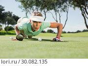 Купить «Female golfer blowing her ball on putting green», фото № 30082135, снято 3 апреля 2014 г. (c) Wavebreak Media / Фотобанк Лори