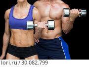 Купить «Bodybuilding couple posing with large dumbells», фото № 30082799, снято 2 апреля 2014 г. (c) Wavebreak Media / Фотобанк Лори