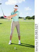 Купить «Lady golfer teeing off for the day», фото № 30083027, снято 3 апреля 2014 г. (c) Wavebreak Media / Фотобанк Лори
