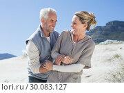 Купить «Attractive couple messing about on the beach», фото № 30083127, снято 3 апреля 2014 г. (c) Wavebreak Media / Фотобанк Лори