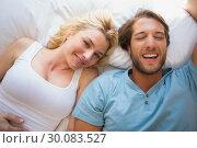 Купить «Happy couple relaxing on bed », фото № 30083527, снято 24 января 2014 г. (c) Wavebreak Media / Фотобанк Лори