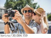 Купить «Hip young couple taking a selfie with camera», фото № 30084159, снято 19 февраля 2014 г. (c) Wavebreak Media / Фотобанк Лори