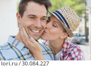Купить «Young hip couple smiling at camera woman kissing mans cheek», фото № 30084227, снято 19 февраля 2014 г. (c) Wavebreak Media / Фотобанк Лори