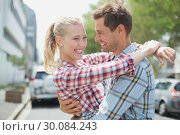 Купить «Couple in check shirts and denim hugging each other», фото № 30084243, снято 19 февраля 2014 г. (c) Wavebreak Media / Фотобанк Лори
