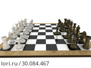 Chess pieces facing off on board. Стоковое фото, агентство Wavebreak Media / Фотобанк Лори