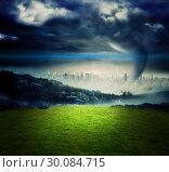 Купить «Tornado over city and moutains», фото № 30084715, снято 29 мая 2014 г. (c) Wavebreak Media / Фотобанк Лори