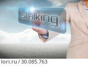 Купить «Businesswoman pointing to word stalking», фото № 30085763, снято 11 июня 2014 г. (c) Wavebreak Media / Фотобанк Лори