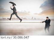 Купить «Young businessman pulling a tightrope for business man», фото № 30086047, снято 11 июня 2014 г. (c) Wavebreak Media / Фотобанк Лори