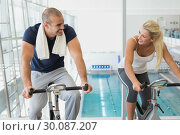Купить «Fit couple working on exercise bikes at gym», фото № 30087207, снято 27 февраля 2014 г. (c) Wavebreak Media / Фотобанк Лори