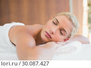 Купить «Beautiful woman lying on massage table at spa center», фото № 30087427, снято 8 апреля 2014 г. (c) Wavebreak Media / Фотобанк Лори