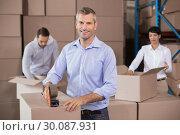 Купить «Warehouse workers packing up boxes», фото № 30087931, снято 10 мая 2014 г. (c) Wavebreak Media / Фотобанк Лори