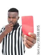 Купить «Serious referee showing red card», фото № 30088815, снято 24 апреля 2014 г. (c) Wavebreak Media / Фотобанк Лори
