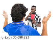 Купить «Referee showing red card to football player», фото № 30088823, снято 24 апреля 2014 г. (c) Wavebreak Media / Фотобанк Лори