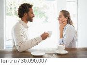 Купить «Happy couple on a date having coffee», фото № 30090007, снято 13 февраля 2014 г. (c) Wavebreak Media / Фотобанк Лори