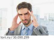 Купить «Businessman suffering from a headache», фото № 30090299, снято 6 мая 2014 г. (c) Wavebreak Media / Фотобанк Лори