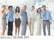 Купить «Cheering workers with raised arms», фото № 30090391, снято 6 мая 2014 г. (c) Wavebreak Media / Фотобанк Лори