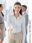 Купить «Smiling business woman offering handshake», фото № 30090427, снято 6 мая 2014 г. (c) Wavebreak Media / Фотобанк Лори