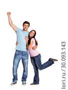 Купить «Young couple cheering at camera», фото № 30093143, снято 2 июля 2014 г. (c) Wavebreak Media / Фотобанк Лори