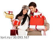 Купить «Young couple with many christmas presents», фото № 30093167, снято 2 июля 2014 г. (c) Wavebreak Media / Фотобанк Лори