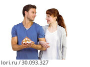 Купить «Couple holding a model house», фото № 30093327, снято 4 июля 2014 г. (c) Wavebreak Media / Фотобанк Лори
