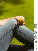 Купить «Close up of a pretty redhead holding flowers», фото № 30094959, снято 5 июня 2014 г. (c) Wavebreak Media / Фотобанк Лори