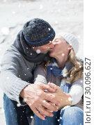 Купить «Composite image of attractive couple kissing on the beach in warm clothing», фото № 30096627, снято 29 августа 2014 г. (c) Wavebreak Media / Фотобанк Лори