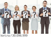 Купить «Business people holding question mark signs», фото № 30096999, снято 8 мая 2014 г. (c) Wavebreak Media / Фотобанк Лори