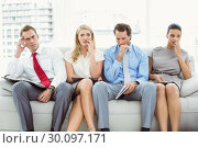 Купить «Nervous executives waiting for interview», фото № 30097171, снято 8 мая 2014 г. (c) Wavebreak Media / Фотобанк Лори