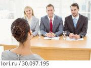 Купить «Business people interviewing woman», фото № 30097195, снято 8 мая 2014 г. (c) Wavebreak Media / Фотобанк Лори