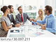 Купить «Young business people in board room meeting», фото № 30097211, снято 8 мая 2014 г. (c) Wavebreak Media / Фотобанк Лори